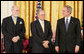 President George W. Bush stands with Presidential Medal of Freedom recipients, Vinton G. Cerf and Robert E. Kahn, Wednesday, Nov. 9, 2005, during ceremonies at the White House. Cerf and Kahn were honored for their work in helping to create the modern Internet. White House photo by Paul Morse