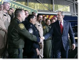 President George W. Bush meets with U.S. Customs and Border Protection officials following his address Monday, Nov. 28, 2005 at the Davis-Monthan Air Force Base in Tucson, Arizona, speaking on the importance of border security and the issue of immigration reform.  White House photo by Eric Draper