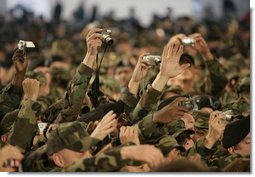 A sea of cameras and hands greet President Bush upon his arrival Saturday, Nov. 19, 2005, to Osan Air Base in Osan, Korea.  White House photo by Eric Draper