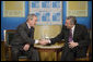 President George W. Bush and President Nestor Carlos Kirchner of Argentina shake hands after their meeting Friday morning, Nov. 4, 2005, at the Hermitage Hotel in Mar del Plata, Argentina. White House photo by Eric Draper