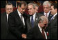 President George W. Bush spends a moment with Mexico's President Vicente Fox following the opening ceremonies Friday, Nov. 4, 2005, of the 2005 Summit of the Americas at the Teatro Auditorium in Mar del Plata, Argentina. White House photo by Eric Draper