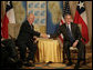President George W. Bush and Chilean President Ricardo Lago Escobar exchange handshakes Friday, Nov. 4, 2005, during their bilateral meeting at the Sheraton Mar del Plata Hotel in Mar del Plata, Argentina. White House photo by Eric Draper