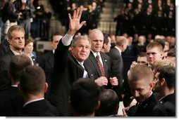 """President Bush waves to the crowd after delivering an emphatic statement on the War on Terror Wednesday, Nov. 30, 2005, at the U.S. Naval Academy in Annapolis. """"Victory in Iraq will demand the continued determination and resolve of the American people,"""" said the President.  White House photo by Paul Morse"""