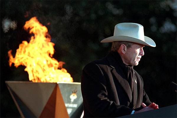 """President George W. Bush speaks during the 2002 Olympic Torch Relay Ceremony on the South Lawn Dec. 22. """"Each torch bearer's story is a lesson in citizenship and courage and compassion,"""" said the President announcing the two torch runners, Liz Howell and Eric Jones. Both runners were profoundly affected by the Sept. 11 attacks. White House photo by Paul Morse."""