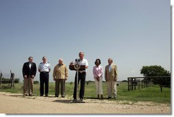 President George W. Bush addresses the media at his Crawford, Texas ranch flanked by members of Defense Policy and Programs Team, Secretary of State, and Foreign Policy Team Thursday, August 11, 2005. White House photo by David Bohrer