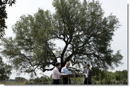 President George W. Bush and Colombian President Alvaro Uribe shake during a joint press conference at the President's Central Texas ranch in Crawford, Texas, on August 4, 2005.  White House photo by Paul Morse