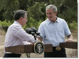 President George W. Bush and Colombian President Alvaro Uribe shake hands during a joint press conference at the President's Central Texas ranch in Crawford, Texas, on August 4, 2005.  White House photo by Paul Morse