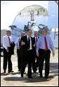 President George W. Bush tours the Sandia Solar Tower Complex lead by Sandia Lab Director Tom Hunter Monday, Aug. 8, 2005 in Albuquerque, New Mexico. Also pictured from left are, Senator Jeff Bingaman (D, NM), Senator Pete Domenici (R, NM) and Secretary of Energy Sam Bodman. White House photo by Eric Draper
