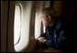 President George W. Bush looks out over the devastation in New Orleans from Hurricane Katrina as he heads back to Washington D.C. Wednesday, Aug. 31, 2005, aboard Air Force One. White House photo by Paul Morse