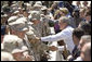President George W. Bush shakes hands with troops at Luke Air Force Base Monday, Aug. 29, 2005, after his arrival in Arizona, where he spoke on Medicare to 400 guests at the Pueblo El Mirage RV Resort and Country Club in nearby El Mirage. White House photo by Paul Morse
