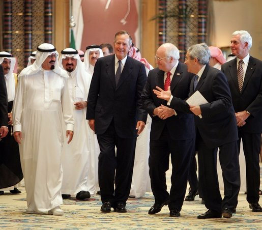 Vice President Dick Cheney and former President George H.W. Bush walks with newly crowned King Abdullah during a retreat at King Abdullah's Farm in Riyadh, Saudi Arabia Friday, August 5, 2005, following the death of his half-brother King Fahd who passed away August 1, 2005. Interpreter Gamal Helal, center, is also pictured. White House photo by David Bohrer
