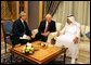 Vice President Dick Cheney speaks with newly crowned King Abdullah during a retreat at King Abdullah's Farm in Riyadh, Saudi Arabia Friday, August 5, 2005, following the death of his half-brother King Fahd who passed away August 1, 2005. Interpreter Gamal Helal, center, is also pictured. White House photo by David Bohrer