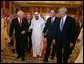 Vice President Dick Cheney walks with newly crowned King Abdullah, former President George H.W. Bush, and former Secretary of State Colin Powell during a retreat at King Abdullah's Farm in Riyadh, Saudi Arabia Friday, August 5, 2005, following the death of Abdullah's half-brother King Fahd who passed away August 1, 2005. White House photo by David Bohrer