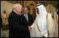 Vice President Dick Cheney, left, shake hands with newly crowned King Abdullah, right, during a retreat at King Abdullah's Farm in Riyadh, Saudi Arabia Friday, August 5, 2005, following the death of his half-brother King Fahd who passed away August 1, 2005. Interperter Gamal Helal, center, is also pictured. White House photo by David Bohrer