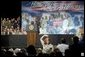 The mother of four sons currently deployed to Iraq, Tammy Pruett, acknowledges the applause of the crowd at Idaho Center Arena, Wednesday, Aug. 24, 2005 in Nampa, Idaho, after she is introduced by President George W. Bush. White House photo by Paul Morse