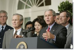 President George W. Bush stands with Secretary of Defense Donald Rumsfeld; Secretary of Labor Elaine Chao and Mike Leavitt, Secretary of Health and Human Services, as he speaks to the media from the Rose Garden of the White House regarding the devastation along the Gulf Coast caused by Hurricane Katrina.  White House photo by Paul Morse