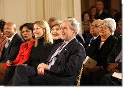 President George W. Bush, Mrs. Laura Bush, Jenna Bush and Secretary of State Condoleezza Rice join the East Room audience in listening to The Temptations Tuesday, Feb. 12, 2008, during a celebration of African American History Month. White House photo by Eric Draper