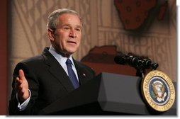 """President George W. Bush gestures as he as he delivers his remarks Thursday, Feb. 14, 2008 at the Smithsonian National Museum of African Art, on his upcoming trip to Africa. Speaking in praise of the continent President Bush said, """"Africa in the 21st century is a continent of potential. It's a place where democracy is advancing, where economies are growing, and leaders are meeting challenges with purpose and determination.""""  White House photo by Chris Greenberg"""