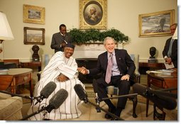 """President George W. Bush and Mali President Amadou Touré meet in the Oval Office Tuesday, Feb. 12, 2008, at the White House. Said President Bush upon welcoming his fellow leader, """"I was touched by the President's concern about the life of the average citizen in Mali. This is a country that's committed to the rights of its people, and we're proud to be standing side-by-side with you.""""  White House photo by Eric Draper"""