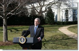 President George W. Bush talks with reporters Thursday, Feb. 14. 2008 on the South Lawn of the White House, urging members of Congress to pass the Protect America Act before legislation authorizing the monitoring of terrorist communications expires Saturday at midnight. White House photo by Chris Greenberg