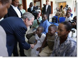 President George W. Bush meets patients and their families Sunday, Feb. 17, 2008, in the reception room of the Amana District Hospital in Dar es Salaam, Tanzania, where President Bush and Mrs. Bush visited a patients and staff at the hospital's care and treament clinic. White House photo by Eric Draper