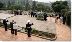 President George W. Bush and Mrs. Laura Bush pause for a moment of silence after laying a wreath on a mass grave at the genocide memorial Tuesday, Feb. 19, 2008, at the Kigali Memorial Centre in Kigali, Rwanda.  White House photo by Shealah Craighead