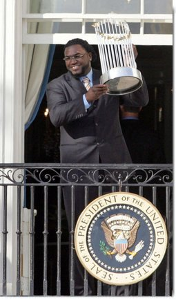 Boston Red Sox's slugger David Ortiz raises the 2007 World Championship Trophy for the crowd during a ceremony honoring the Boston Red Sox Wednesday, Feb. 27, 2008, at the White House. White House photo by Joyce N. Boghosian