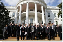 President George W. Bush and Vice President Dick Cheney stand with the 2007 World Series Champion Boston Red Sox Wednesday, Feb. 27, 2008, on the South Lawn of the White House. White House photo by Chris Greenberg