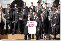 President George W. Bush is presented with a personalized Boston Red Sox jersey from team captain Jason Varitek, as President Bush honored the 2007 World Series Champions Wednesday, Feb. 27, 2008, on the South Lawn of the White House. White House photo by Joyce N. Boghosian