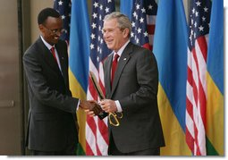President George W. Bush and President Paul Kagame shake hands Tuesday, Feb. 19, 2008, following the dedication and ribbon cutting ceremony to formally open the new United States Embassy in Kigali, Rwanda. White House photo by Chris Greenberg