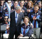 President George W. Bush is given an Olympic torch by Chris Devlin-Young, a U.S. Paralympic gold-medalist, during a South Lawn ceremony Wednesday, May 17, 2006, at the White House in honor of the 2006 U.S. Winter Olympics and Paralympics teams. White House photo by Shealah Craighead