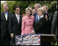 President George W. Bush puts his arms around U.S. Senator Kay Bailey Hutchison (R-Texas) and Ohio Congresswoman Deborah Pryce, right, after signing H.R. 4297, the Tax Relief Extension Reconciliation Act of 2005, during ceremonies Wednesday, May 17, 2006, on the South Lawn of the White House. White House photo by Eric Draper