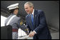 President George W. Bush presents a diploma to class valedictorian Jessamyn Jade Liu during 2006 graduation ceremonies Saturday, May 27, 2006, at the U.S. Military Academy in West Point, N.Y. White House photo by Shealah Craighead