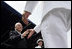 """Vice President Dick Cheney greets each graduate as they receive their diplomas during the U.S. Naval Academy graduation in Annapolis, Maryland, Friday, May 27, 2005. During the ceremony the Vice President delivered the commencement address to the Class of 2006 and said, """"As of today, you, the Custodians of Liberty, will begin writing your own chapter of excellence and achievement for the United States Armed Forces. As military officers you will bring relief to the helpless, hope to the oppressed. You will protect the United States of America in a time of war, and you'll help to build the peace that freedom brings."""""""