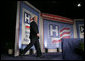 """President George W. Bush steps onto the stage at the Washington Hilton Hotel Monday, May 1, 2006, prior to delivering his remarks on health care initiatives. Said the President, """"America has the best health care system in the world, pure and simple."""" White House photo by Paul Morse"""