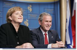 President George W. Bush shares a moment with Chancellor Angela Merkel of the Federal Republic of Germany, during the American Jewish Committee's Centennial Dinner Thursday, May 4, 2006, at the National Building Museum in Washington, D.C.  White House photo by Paul Morse