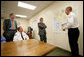 President George W. Bush and Florida Governor Jeb Bush receive a briefing on brush fires at the Hillsborough County Fire Station in Sun City Center, Florida, Tuesday, May 9, 2006. White House photo by Eric Draper