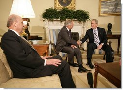 """President George W. Bush shakes the hand of Porter Goss Friday, May 5, 2006, in the Oval Office after the Director of the Central Intelligence Agency announced his resignation. The President thanked him for his service and said of Director Goss, """"He honors the proud history of the CIA."""" Looking on is Ambassador John Negroponte, Director of National Intelligence. White House photo by Eric Draper"""