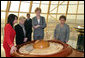 Mrs. Lynne Cheney looks at a display Friday, May 5, 2006, commemorating the first Congress of World Religions, an initiative of President Nazarbayev, that was held in Astana, Kazakhstan in 2003. With her from left are: Murat Gabdrashitov Sapargaliyev, director of Biterek; Maryjo Ordway, wife of John Ordway, U.S. Ambassador to Kazakhstan, and Sabilya Mustafina, deputy Mayor of Astana. Photo by Aleksandr Zhabchuk