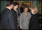 Mrs. Lynne Cheney listens to an interpreter, as she's greeted by Sabilya Mustafina, center, deputy Mayor of Astana, as she arrives at Biterek. Vice President Dick Cheney and Mrs. Cheney arrived in Kazakhstan Friday, May 5, 2006. Photo by Aleksandr Zhabchuk