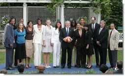 President George W. Bush poses with the Sacramento Monarchs, the 2005 Women's National Basketball Association Champions, Tuesday, May 16, 2006 during a congratulatory ceremony held in the East Garden at the White House. In September 2005, the Monarchs clinched their first WNBA Championship title by defeating the Connecticut Sun, 3 games to 1.  White House photo by Kimberlee Hewitt