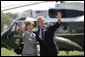 President George W. Bush and Mrs. Laura Bush wave to guests on the South Lawn Friday, May 12, 2006, before boarding Marine One en route Camp David. White House photo by Eric Draper