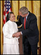 """President George W. Bush awards Sister Theresa Pham of Houston with the President's Volunteer Service Award during an event celebrating Asian Pacific American Heritage Month in the East Room Friday, May 12, 2006. """"I created this award because I understand the great strength of the United States of America is not found in our military, and it's certainly not because of the size of our wallets, it's because the strength of America is found in the hearts and souls of generous citizens who answer to a universal call to love a neighbor like you'd like to be loved yourself,"""" said the President White House photo by Paul Morse"""