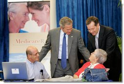 President George W. Bush and Health and Human Services Secretary Mike Leavitt with seniors at a Medicare Prescription Drug Benefit Enrollment Event at Broward Community College in Coconut Creek, Fla., Tuesday, May 9, 2006.  White House photo by Eric Draper