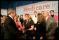 President George W. Bush greets audience members at the end of A Conversation on the Medicare Prescription Drug Benefit at the Asociacion Borinquena de Florida Central, Inc., in Orlando Wednesday, May 10, 2006. White House photo by Eric Draper
