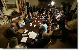 Members of the media gather as President George W. Bush meets with Victims of Identity Theft Wednesday, May 10, 2006, in the Roosevelt Room of the White House. White House photo by Eric Draper