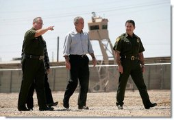 President George W. Bush tours the Yuma sector near the U.S. Mexico border led by Chief Patrol Agent Ronald Colburn, left, and Chief of the Border Patrol David Aguilar in Yuma, Arizona, Thursday, May 18, 2006. White House photo by Eric Draper