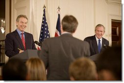 President George W. Bush and British Prime Minister Tony Blair participate in a joint news conference Thursday evening May 25, 2006 in the East Room of the White House, where the two leaders vowed their support to the new government of Iraq. White House photo by Eric Draper