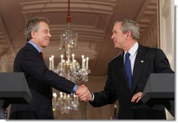 President George W. Bush and Prime Minister Tony Blair of Great Britain shake hands following a joint press availability Thursday, May 25, 2006, in the East Room of the White House during which they pledged their continued support for Iraq's new government. White House photo by Shealah Craighead