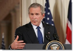 """President George W. Bush speaks to the audience Thursday night, May 25, 2006, in the East Room during a joint press availability with Prime Minister Tony Blair of Great Britain. Said the President about Iraq's new government, """"As we celebrate this historic moment, it's important to recall how we got there, and take stock in how far we've come."""" White House photo by Shealah Craighead"""
